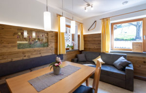 Kitchen with living room of the apartment Santner in the Dolomites